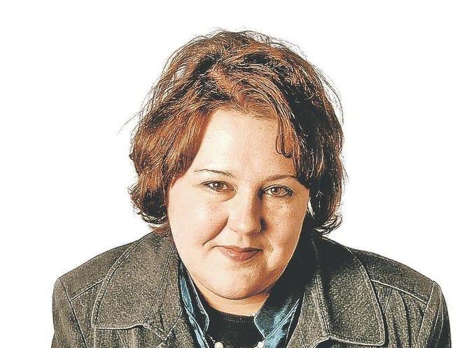 Matt Wittmeyer  Marketta Bakke with a picture taken when she was younger.