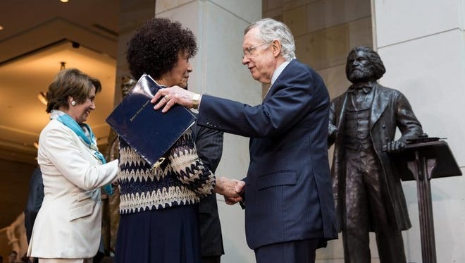 WASHINGTON, DC - JUNE 19: Senate Majority Leader Harry Reid (D-NV) (R) speaks with Nettie Washington Douglass, great great granddaughter of Frederick Douglass, during a dedication ceremony for the new Frederick Douglass Statue in Emancipation Hall in the Capitol Visitor Center, at the U.S. Capitol, on June 19, 2013 in Washington, DC. The 7 foot bronze statue of Douglass joins fellow black Americans Rosa Parks, Martin Luther King Jr. and Sojourner Truth on permanent display in the Capitol's Emancipation Hall. (Drew Angerer/Getty Images)