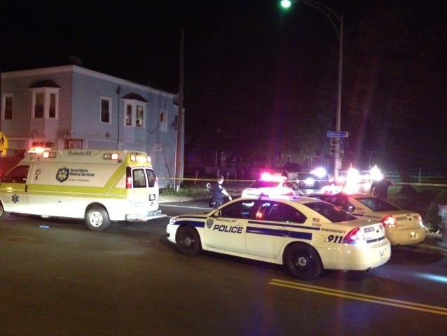 Rochester police officers respond to a shooting at the corner of Flint Street and Jefferson Avenue.