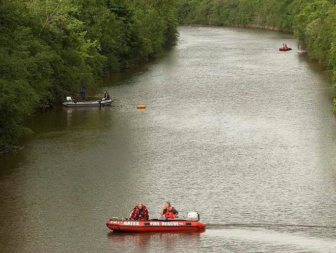 Water rescue crews from the Gates Fire Department search for a person who was heard screaming for help in the canal.