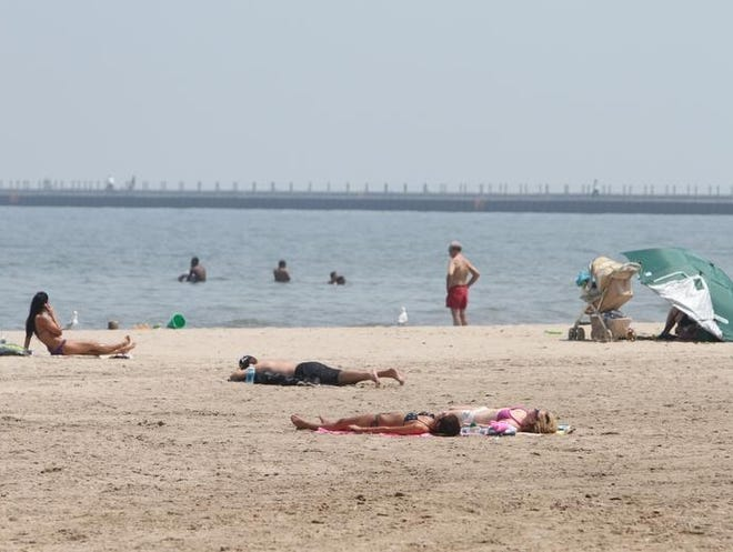 Today's warm weather brought people out to Ontario Beach Park on June 8, 2011.  Democrat and Chronicle staff photo by Tina Yee