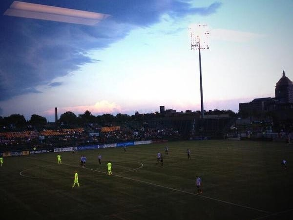 Storm clouds move over Sahlen's Stadium in Rochester Friday night.