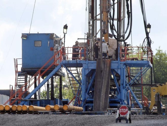 A 2012 file photo of a crew working on a gas drilling rig at a well site for shale based natural gas in Zelienople, Pa.