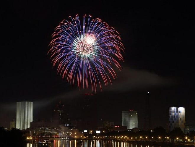 Downtown fireworks underway in Rochester on July Fourth 2013. This view is looking northeast over the Frederick Douglass Susan B. Anthony Bridge.