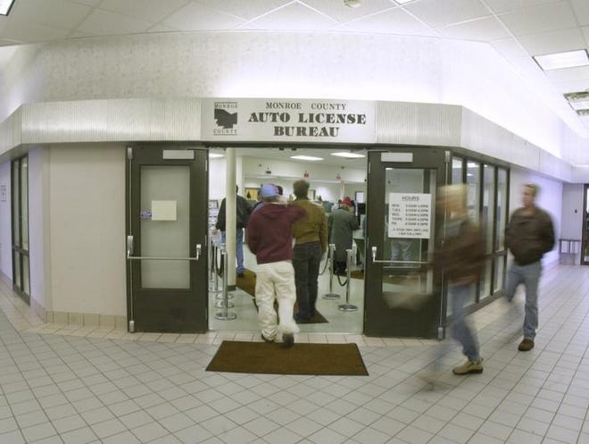 \People arrive at the Department of Motor Vehicles Office on Titus Avenue in Irondequoit in 2003.