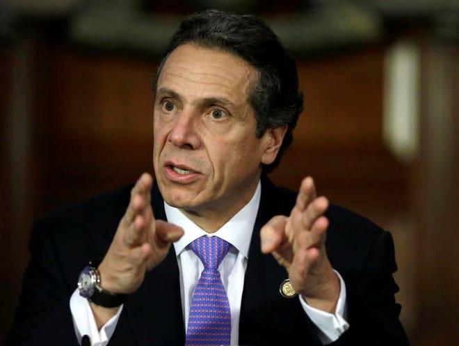 New York Gov. Andrew Cuomo on Monday, Jan. 7, 2013, in Albany, N.Y. (AP Photo/Mike Groll)