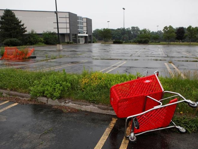 A shopping cart gone astray in the vacant parking lot by the former entrance to the Medley Centre food court. The Democrat and Chronicle recently published a watchdog report on the mall's current state.