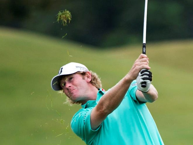 Brandt Snedeker hits an approach shot on the 18th hole during the third round of the Canadian Open golf tournament at Glen Abbey in Oakville, Ontario, Saturday.