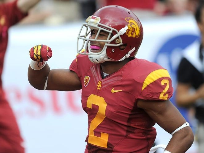 October 20, 2012; Los Angeles, CA, USA;    Southern California Trojans wide receiver Robert Woods (2) celebrates after scoring a touchdown in the first half of the game against the Colorado Buffaloes at the Los Angeles Coliseum.  Mandatory Credit: Jayne Kamin-Oncea-USA TODAY Sports