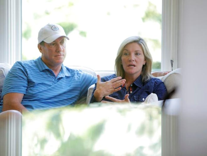 Left, Jim Kelly (former Buffalo Bills quarterback) and his wife Jill at their home in in Orchard Park, N.Y. on Wednesday, September 1 2010. A new book by Jill Kelly called Without a Word will hit the book stores. Reporter is Chris Swingle. (Democrat & Chronicle, Staff Photo by Carlos Ortiz, 090110).