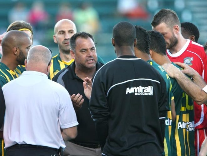 Rochester Rhinos vs Harrisburg City Islanders: Center, Rhinos head coach Jesse Myers talks to players before the game at Sahlen's Stadium in Rochester, N.Y. on Saturday, May 4 2013.