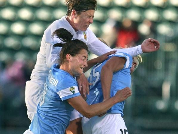Western New York Flash host Chicago: Left, Chicago's Jackie Santacaterina, above Flash's Abby Wambachand Chicago's Lauren Fowlkes jump for the ball in a scoreless first half at Sahlen's Stadium in Rochester, N.Y. on Friday, May 24 2013.