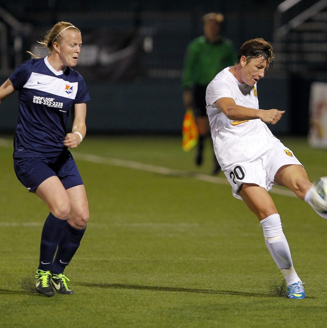 Flash's Abby Wambach, right, sends a long shot in past a Sky Blue defender during National Women's Soccer League action between the Sky Blue FC and the WNY Flash at Sahlen's Stadium in Rochester Wednesday evening, May 1, 2013. The WNY Flash won their first game, 2-1, to hand Sky Blue their first loss.