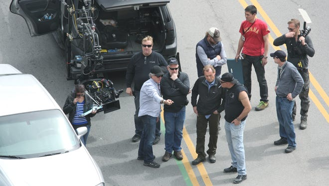 Film crews talks about a scene during The Amazing Spider-Man 2 movie shoot in Rochester.