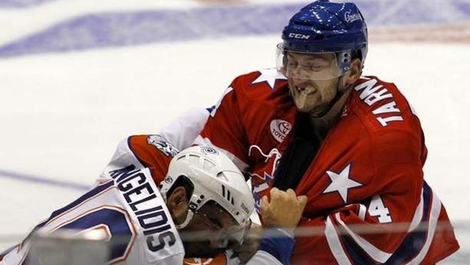 Amerks forward Nick Tarnasky, right, has brought more than just toughness to Rochester this season.