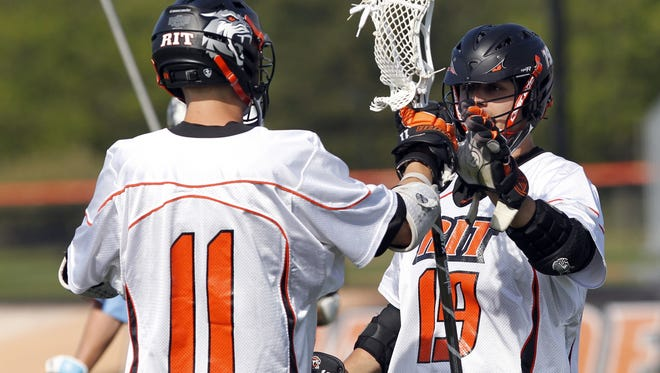 RIT's Kyle Aquin, right, celebrates a goal with Taylor Wisman during NCAA Division III quarterfinals against Tufts.