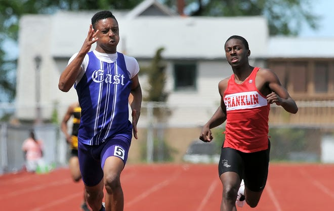 East's Nicodemus Gambill, left, wins the boys 400 meter dash in front of Franklin/NE-NW Prep's Amir Rogers during the R.C.A.C. Track Championships held at Franklin High School on Friday, May 17, 2013.