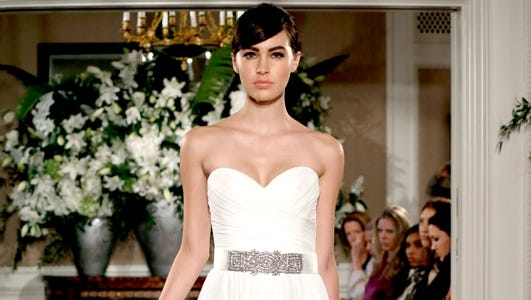 One of the few opportunities for brides to be a little bare is to go with a strapless or sleeveless dress.