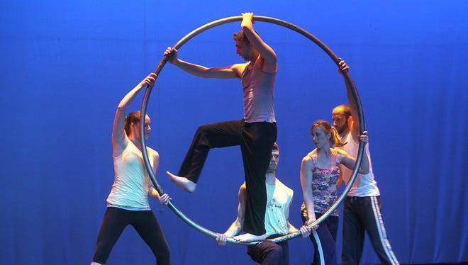 Center, Avi Pryntz-Nadworny of Brighton is held inside a cyr wheel by cast members during the rehearsal of Arc of Ages by PUSH Physical Theatre.