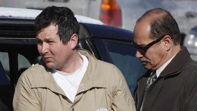 Gary Hyde is escorted into the federal courthouse in Rochester.