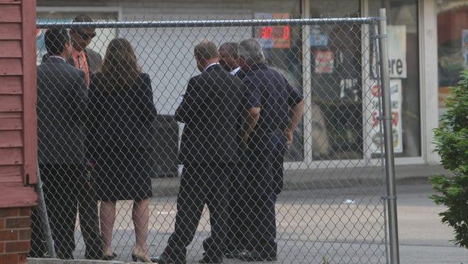 Police investigate a crime scene on Dewey Avenue Thursday.