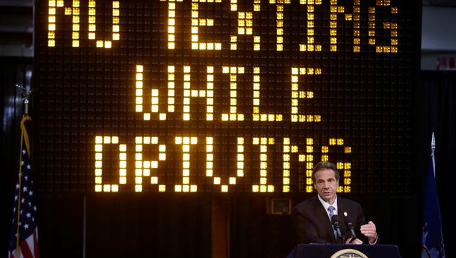 New York Gov. Andrew Cuomo speaks during a news conference to announce the increase in penalties for texting while driving.