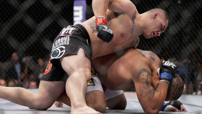 Cain Velasquez, left, throws punches at Antonio Silva in the first round of the UFC 160 MMA heavyweight title bout May 25 in Las Vegas. Velasquez won by technical knockout in the first round.