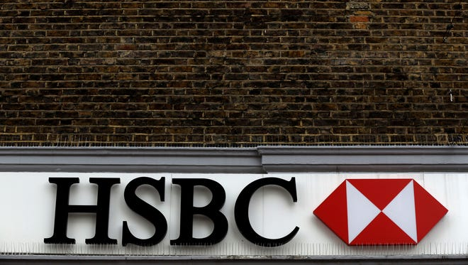 A file photo of a nameplate sign above a branch of the HSBC bank in London.
