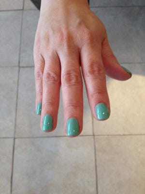 Allure magazine selected Essie's Turquoise , Caicos polish as an editor's pick this summer, commenting that the blend of blue and green looks gorgeous on short, rounded nails.