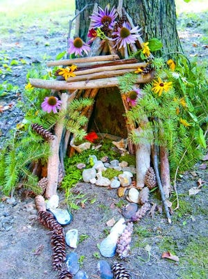 A fairy house uses natural elements and is left in a natural setting.