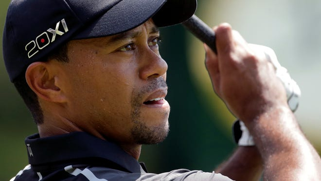 Tiger Woods watches a shot on the driving range during practice for the U.S. Open at Merion Golf Club on Tuesday.