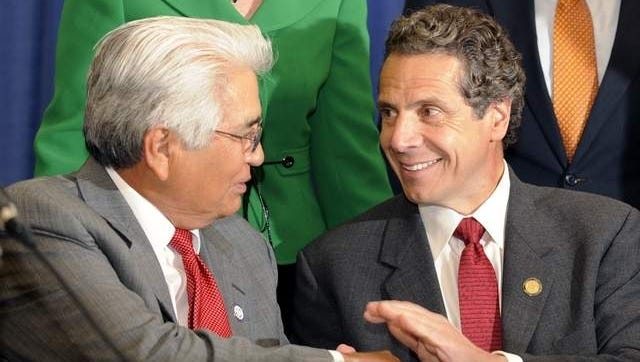 Seneca Nations' President Barry Snyder, left, shakes hands with New York Governor Andrew Cuomo during Thursday's news conference in Niagara Falls.