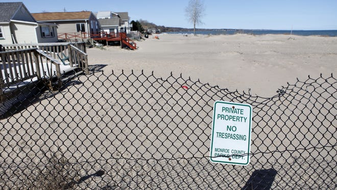 The town of Irondequoit enacted a law barring boaters from tying together and anchoring in the shallows off this Lake Ontario beach.