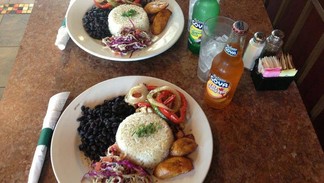 Casado Tico consists of rice and beans with fried plantains, cabbage salad and choice of chicken or beef with peppers and onions.
