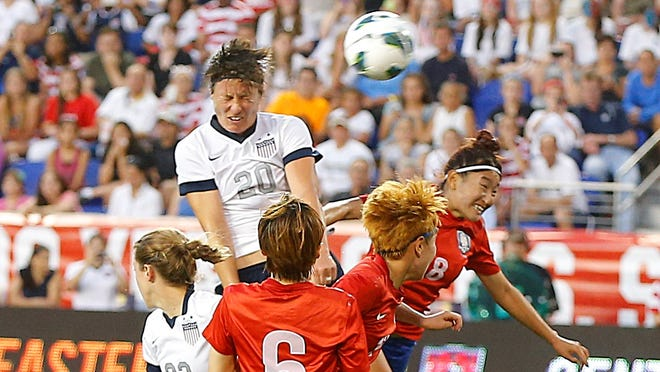 Abby Wambach (20) scores her third goal of the first half and her career 159th goal to become the women's all-time leading goal scorer against South Korea on Thursday.