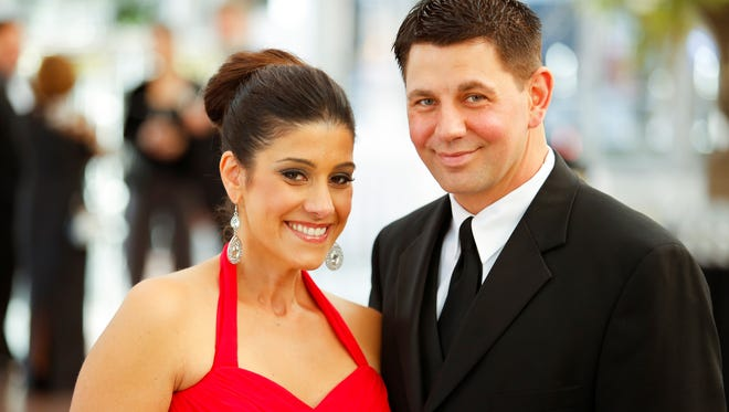 Georgiana Zicari received The Inspiration Award at the Wilmot Cancer Center's Discovery Ball. Here she is shown at the event with her husband.