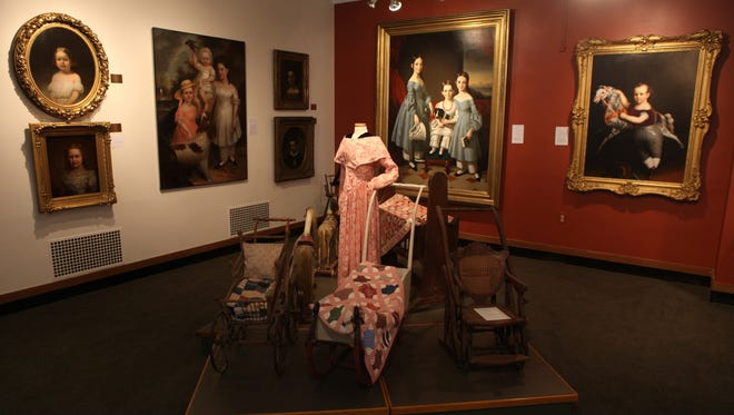 Antique paintings are part of the 200,000-piece collection owned by the Rochester Historical Society.