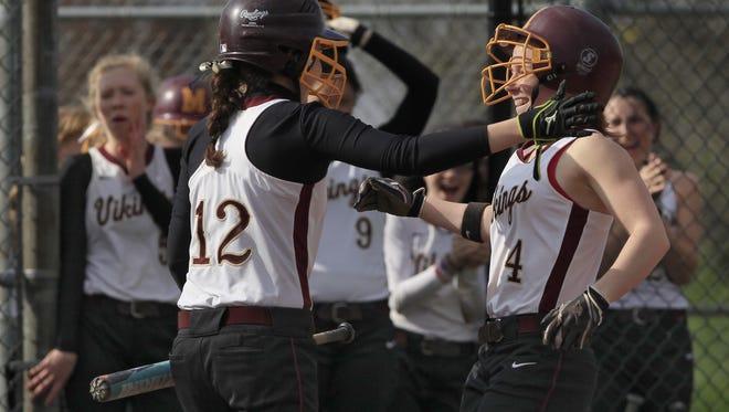 Pittsford Mendon?s Alyssa Friedman, left, congratulates teammate Courtney Case as they score against Fairport.
