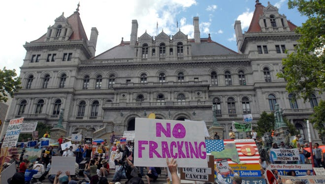 Protesters rally against hydraulic fracturing at the Capitol in Albany on June 17, 2013.