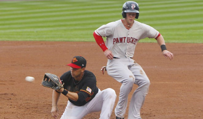 Rochester's Chris Colabello, left, tries to catch Pawtucket's Jeremy Hazelbaker leading off of first during baseball action between the Pawtucket Red Sox and the Rochester Red Wings at Frontier Field in Rochester Friday evening, July 5, 2013.
