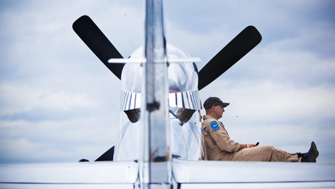 "Scott Yoak of West Virginia watches the Geneseo Airshow from the wing of his P-SI mustang ""Quick Silver"" aircraft during the Geneseo Airshow on Saturday, July 13, 2013."