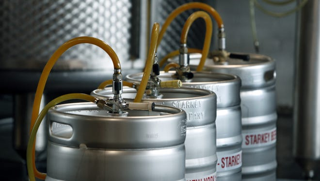 Beer kegs are filled at Rohrbach Brewing Co.'s location at the Rochester Public Market on Railroad Street.