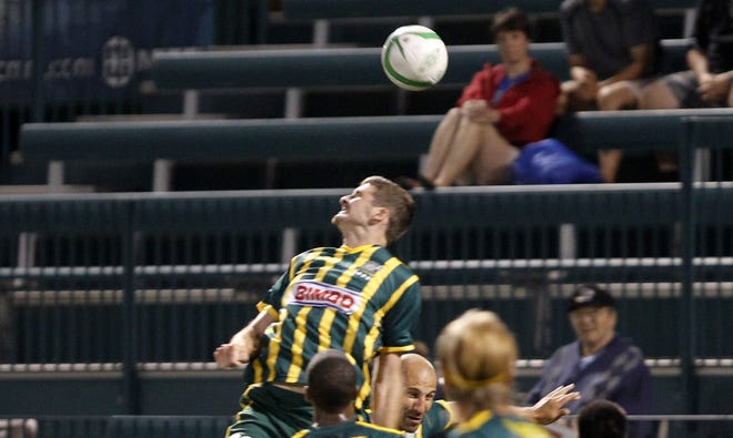 Rochester's Andrew Hoxie, top, gets a head on a corner kick in traffic during USL soccer action between the VSI Tampa Bay FC and the Rochester Rhinos at Sahlen's Stadium in Rochester Friday evening, June 14, 2012.