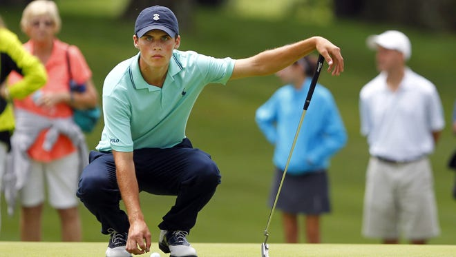 Gavin Hall lines up a putt on the final hole to seal the victory during the final round of the RDGA championship at the Irondequoit Country Club in Pittsford on Saturday, July 20, 2013.