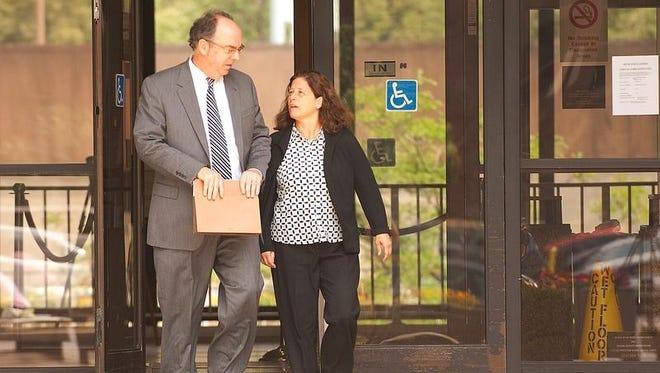 Debra Bulter, right, and her attorney, William Easton.