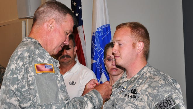 New York Army National Guard Sgt. Joshua Young of Perinton, right.