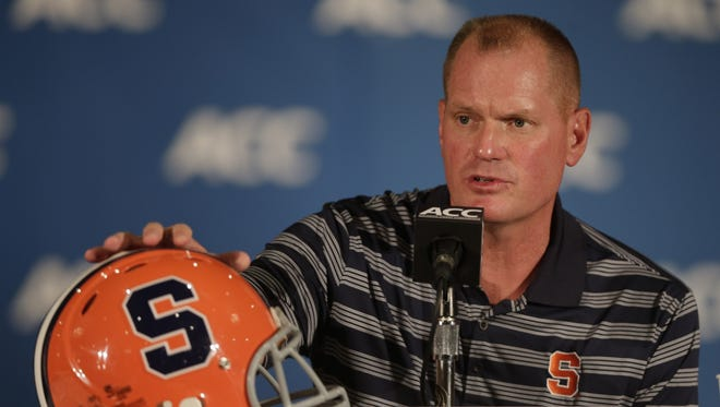 Syracuse head coach Scott Shafer speaks to the media at a news conference during the Atlantic Coast Conference college football media day in Greensboro, N.C., Monday, July 22, 2013.