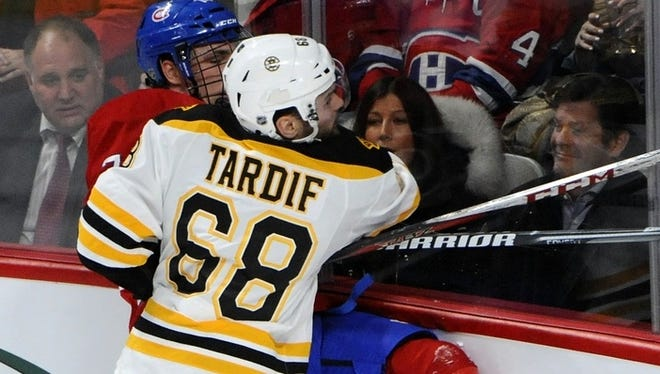 Boston Bruins forward Jamie Tardif (68) hits Montreal Canadiens defenseman Alexei Yemelin (74).