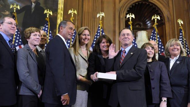 House Speaker John Boehner of Ohio reenacts the swearing in of Rep. Richard Hanna, R-N.Y., Wednesday, Jan. 5, 2011, on Capitol Hill in Washington.