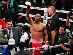 Andre Ward celebrates after beating Chad Dawson in a super middleweight championship bout Saturday in Oakland.